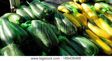 A table display of fresh nutritious vegetables at a farmer's market includes Zucchini ‎(Cucurbita pepo) Market located in Gosford New South Wales Australia.