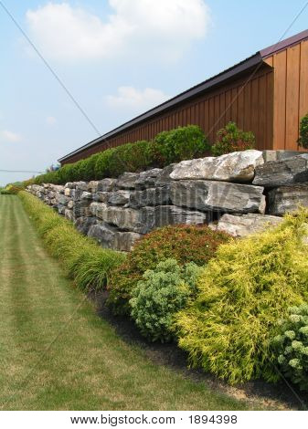 Boulder Wall With Landscaping