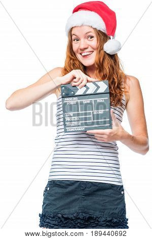 Cheerful Girl In Santa Hat With Clapper Film In Hands On White Background