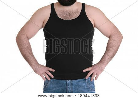 Adult man in undershirt and jeans on white background. Weight loss concept