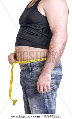 Adult man in undershirt, jeans and tape-measure on white background. Weight loss concept