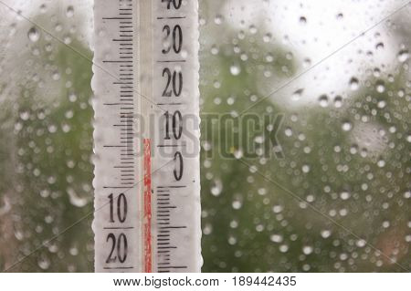 Thermometer Outside The Window Rain