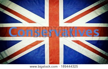 Close up of a British flag with Conservatives text and texture and vignette.