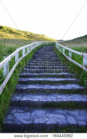 Stone Stairs Go Up to the Top of Mountain in A Sunny Day