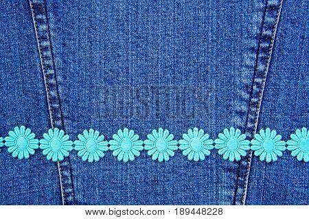 Daisy chain ribbon on blue denim background