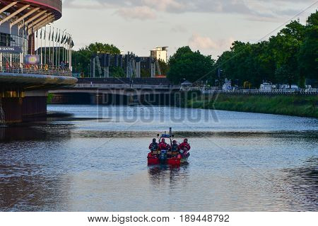 CARDIFF UK - 3 JUNE 2017 Fire and Rescue boat on River Taff by Principality Stadium. British police and security services on high alert as hundreds of thousands of fans enjoy football in the capital of Wales