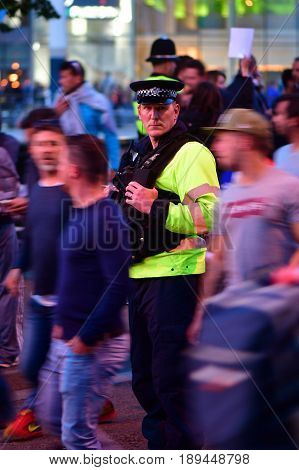 CARDIFF UK - 3 JUNE 2017 Policeman amongst fans during Champions League Final. British police and security services on high alert as hundreds of thousands of fans enjoy football in the capital of Wales