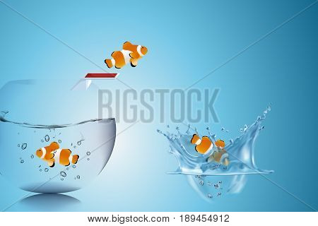 Business Challenge and Growth Concept : Goldfish escape from fishbowl by use springboard and jumping to water pond. (3D Illustration)