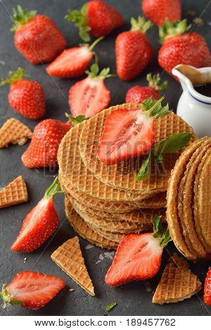 Holland waffles with caramel on a gray background