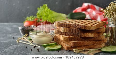Ingredients for sandwich on a gray background