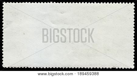 Photo of a blank postage stamp on black background