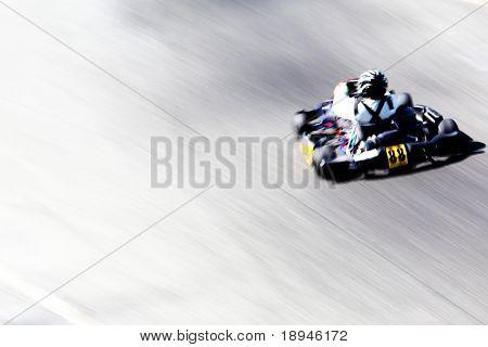 Panning shot of a go-kart racer. Horizontal orientation.