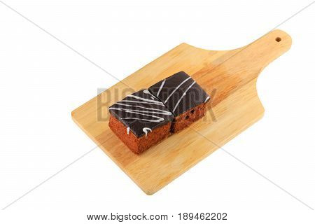 chocolate cake pour cream on cutting board isolated white background and clipping path. select focus with shallow depth of field