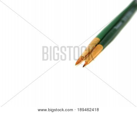 two paint art dirty brushe green handle on white background