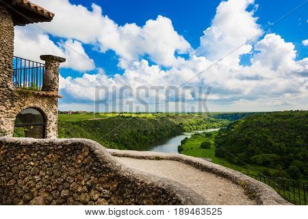 Travel in Dominican Republic. View from the town of Altos de Chavon on the river chavon