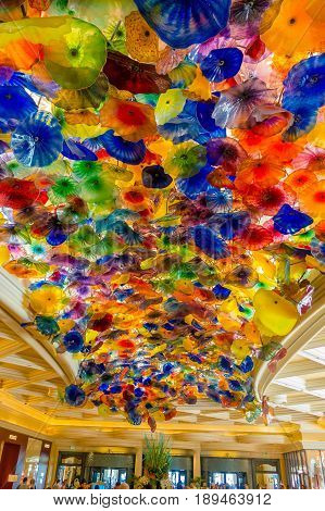 LAS VEGAS, NV - NOVEMBER 21, 2016: The Hand Blown Glass Flower Ceiling at the Bellagio Hotel on November 8, 2014 in Las Vegas is comprised of 2, 000 over glass blossoms by world-renowned glass sculptor Dale Chihuly.