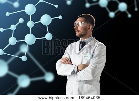 science, biology and people concept - male doctor or scientist in white coat and safety with molecules over black background