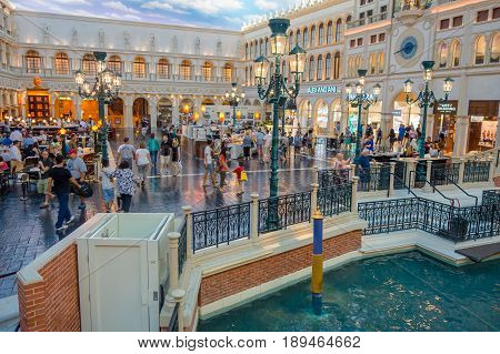 LAS VEGAS, NV - NOVEMBER 21, 2016: An unidentified people walking in the plaza of the Venetian hotel replica of a Grand canal in Las Vegas with more than 4000 suites it s one of the most famous hotels in the world.