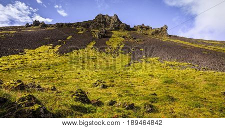 Volcanic rock formations in Reykjadalur Valley in South Iceland