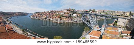 Panoramic view of Porto city with Douro river and Dom Luis I bridge at sunny summer day Portugal