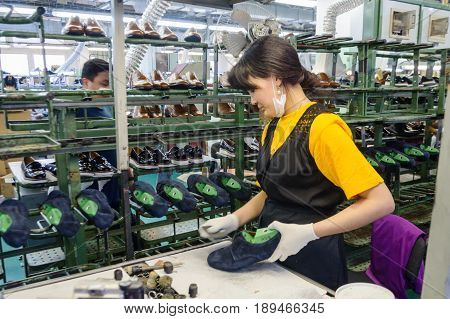 MOSCOW, RUSSIA - FEBRUARY 21, 2017: Moscow shoe factory JSC RALF RINGER. The conveyor of the shoe factory