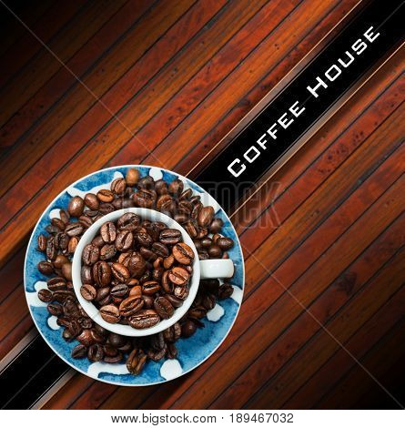 Template for a coffee house menu with a cup with roasted coffee beans. On a wooden background