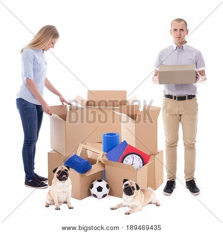moving day concept - couple packing cardboard boxes isolated on white background