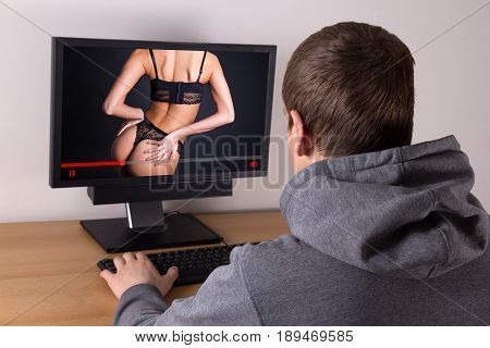 man watching erotic video with young beautiful sexy woman in lingerie