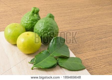 Vegetable and Herb Kaffir Lime with Persian Lime and Kaffir Leaves for Seasoning in Cooking with Copy Space on Text Decorated.