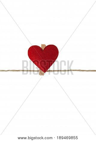 One heart with clothes pegs on a cord, isolated on white