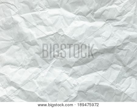 White sheet of paper folded. Crushed and folded white sheet of paper. Note paper. Wrinkled paper.