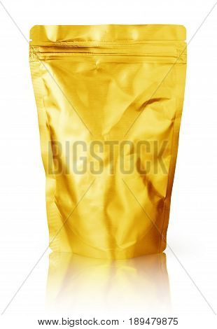 Blank golden foil plastic pouch food packaging isolated on white background. Single gold aluminum coffee package bag with clipping path.