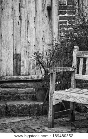 Typical Quintessential Old English Country Garden Image Of Wooden Chair Next To Vintage Back Door In