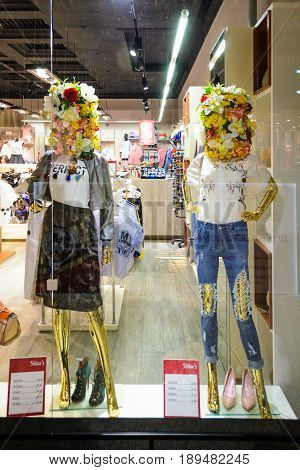 Belarus Minsk - April 12 2017: Shop window decoration in the boutique of the shopping center. Bouquets of flowers instead of heads in mannequins. Two female dummies in a shop window