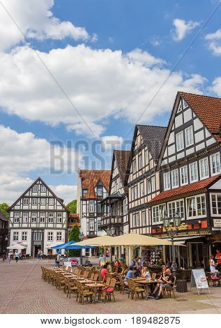 RINTELN, GERMANY - MAY 22, 2017: People at a cafe on the central market square of Rinteln, Germany