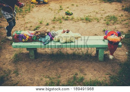 Abandoned toys on the bench an abandoned child unattended conceptual Retro style