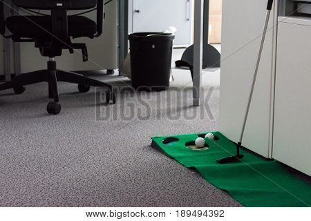 Putting Green in Modern White Office Corporate Fun Entertainment Sport Putter Balls Hole