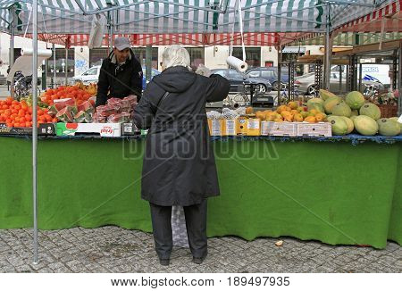 Man Is Selling Fruits And Berries Outdoor In Malmo, Sweden