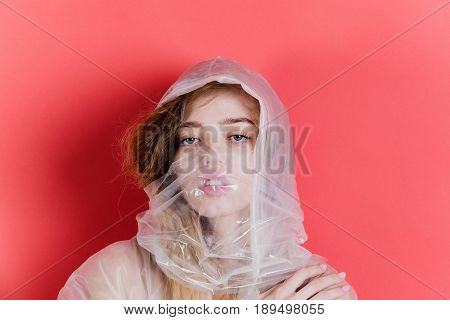 Fashion Woman With Polyethylene Or Plastic Raincoat And Bag