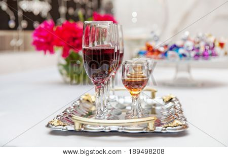 Alcohol in wine glasses wine and cognac in a glass