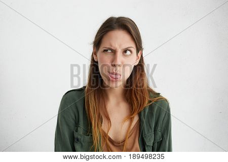 Crazy Attractive Woman Showing Her Tongue Frowning Eyes Looking Aside Having Joy. Caucasian Female S