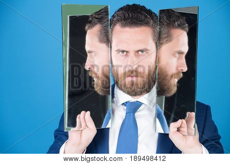 Business Man With Beard, Holding Mirror With Face Reflection