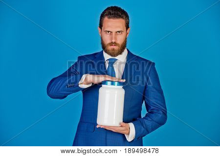 Man Or Bearded Businessman With Plastic Jar On Blue Background