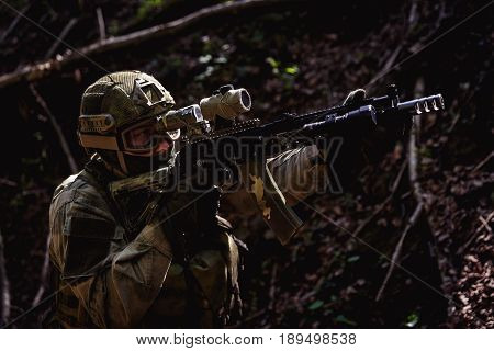 Portrait of soldiers on battlefield with machine guns