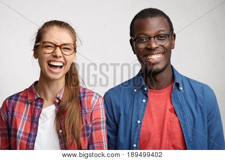 Interracial Friends Standing Shoulder To Shoulder Having Sincere Smile And Emotions. Young Couple Po