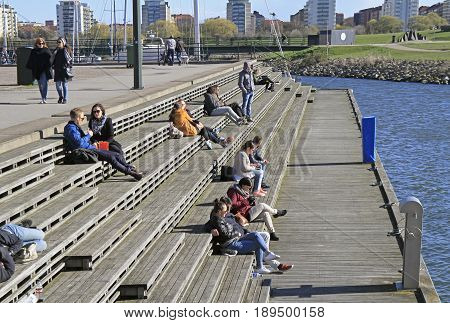 People Are Sitting And Enjoying View Of Sea In Malmo, Sweden