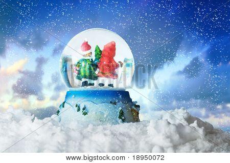 Christmas snow globe on winter snowy sky