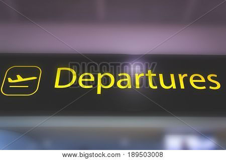 Information sign showing way to departure gates at Heathrow Airport in London England.