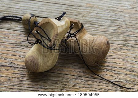 little wooden shoes on a wooden substrate