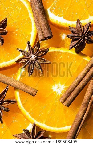 bright orange background from slices of juicy oranges with anise stars. orange background from slices of juicy oranges with anise stars, cinnamon